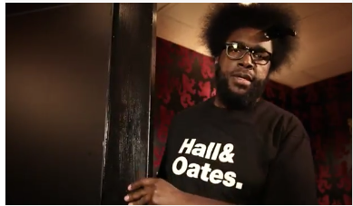 ?uestlove of The Legendary Roots Crew is rocking a Hall & Oates shirt.